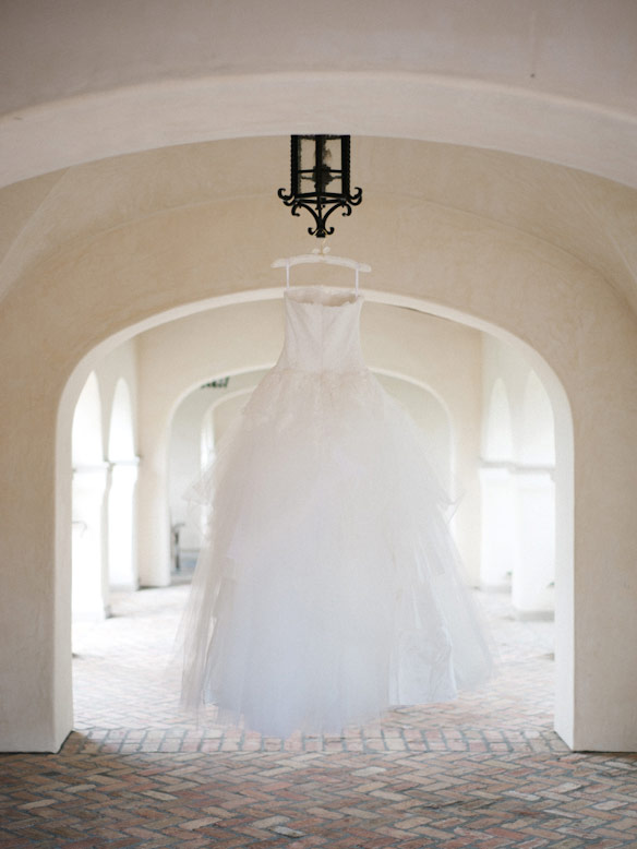 custom dress hangs from chandelier at crosby rancho santa fe