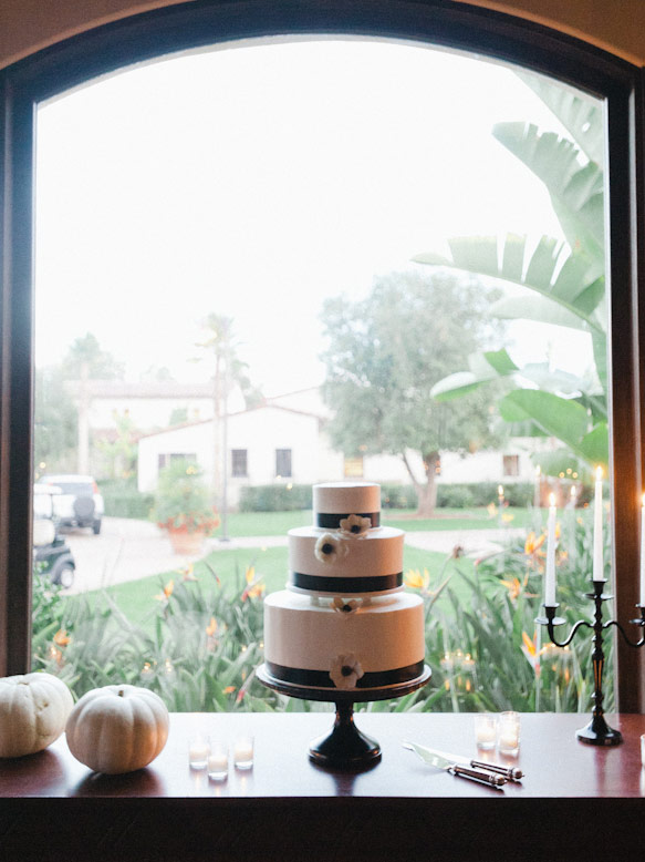 black and white three tier wedding cake near window at crosby club