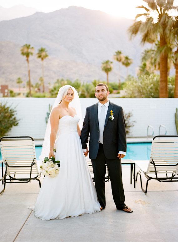 bride and groom pose at pool at l'horizon hotel wedding