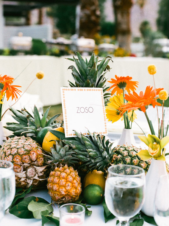 pineapples and bright flower centerpieces palm springs wedding