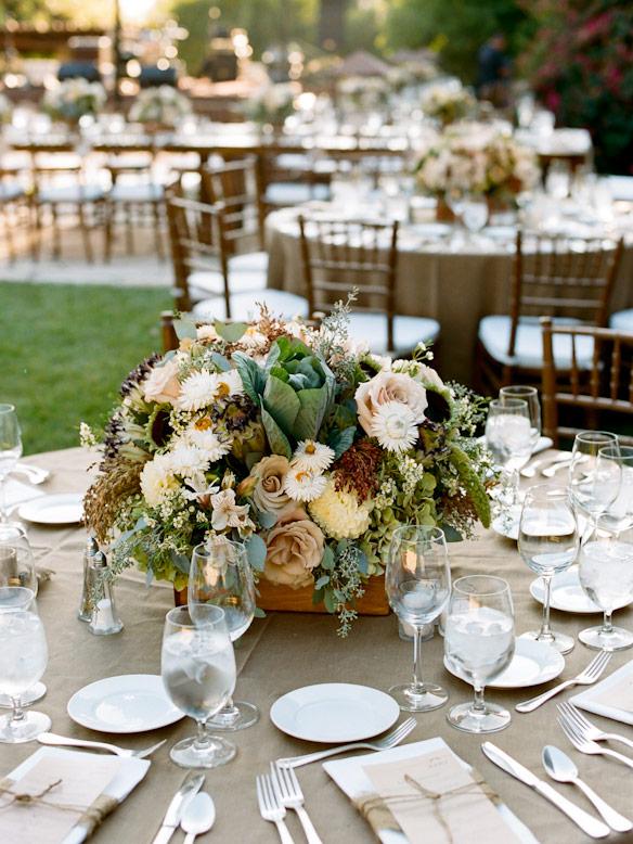 burlap table linen and rustic floral arrangement
