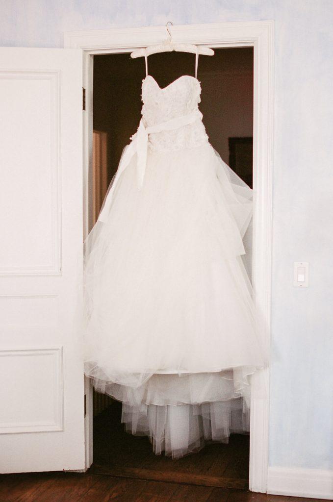 designer-gown-hangs-in-doorway-laughton-estate-wedding