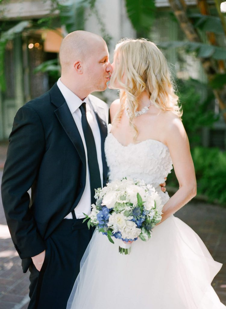 bride and groom kiss at laughton estate wedding