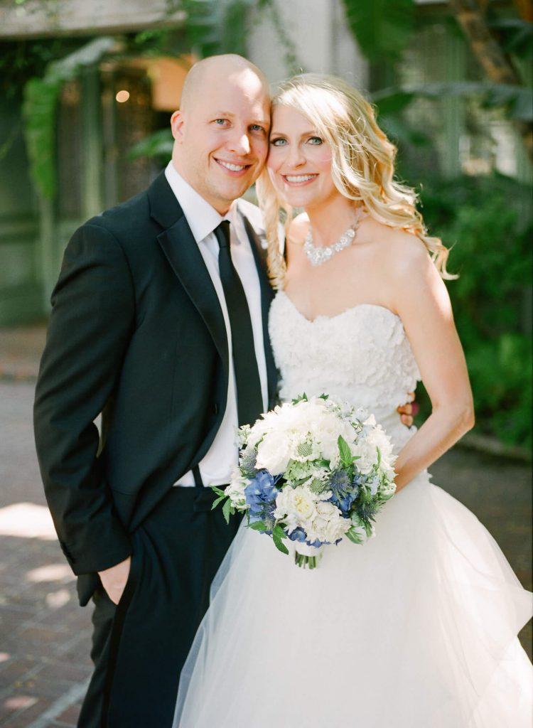 bride and groom pose at laughton estate weding
