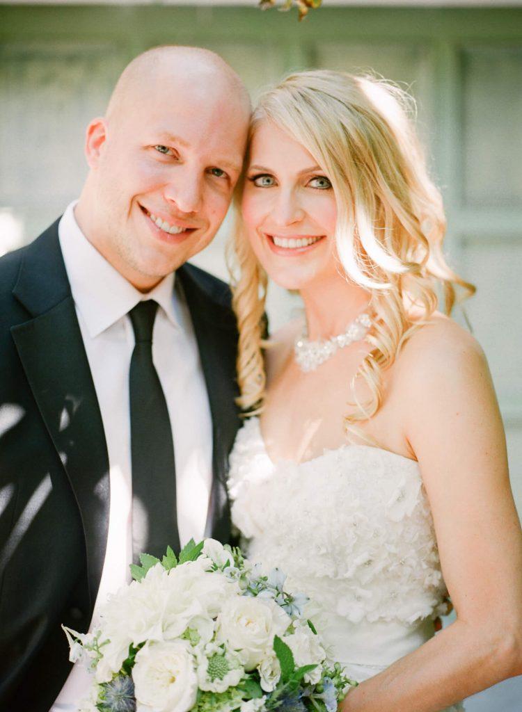 bride and groom pose before laughton estate wedding