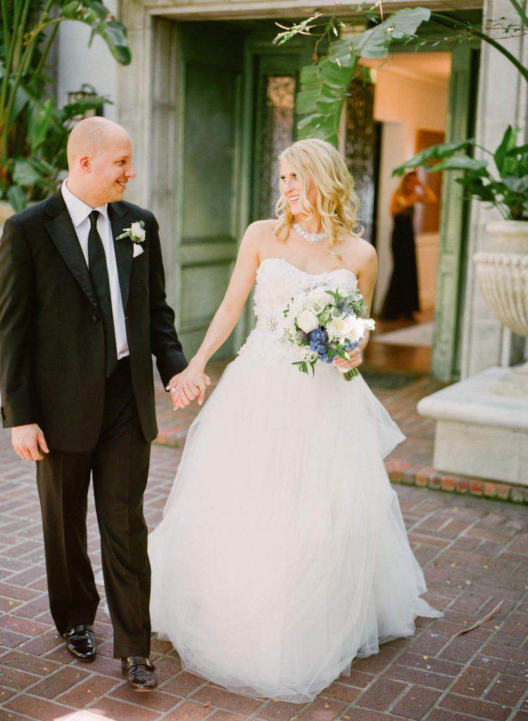 bride and groom walk in laughton estate courtyard