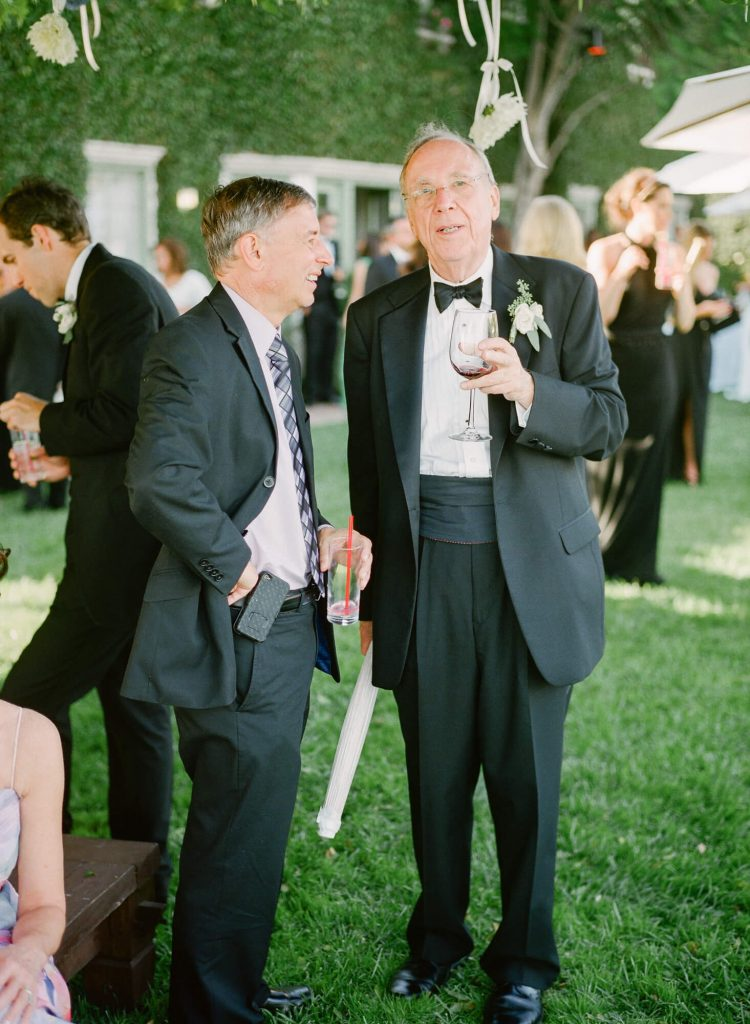 wedding guest in tuxedo during cocktail hour on lawn at laughton estate