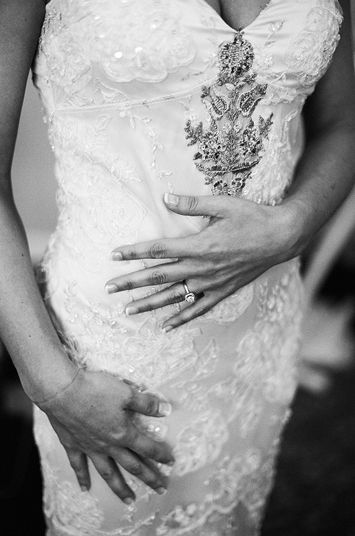 bride's hands resting on front of vintage claire pettibone gown