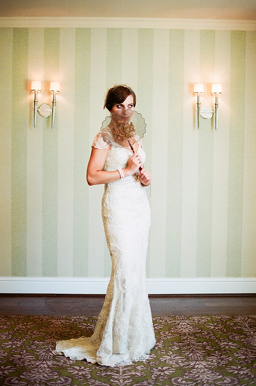 vintage bride wearing claire pettibone gown posing in green room at l'auberge del mar