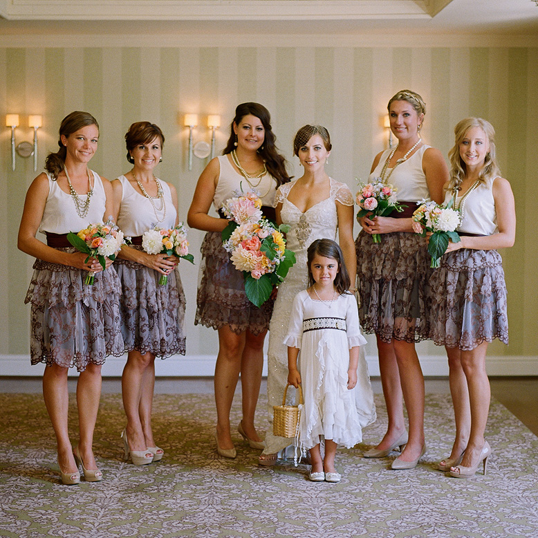 bride and bridesmaids in vintage dresses pose during l'auberge del mar wedding
