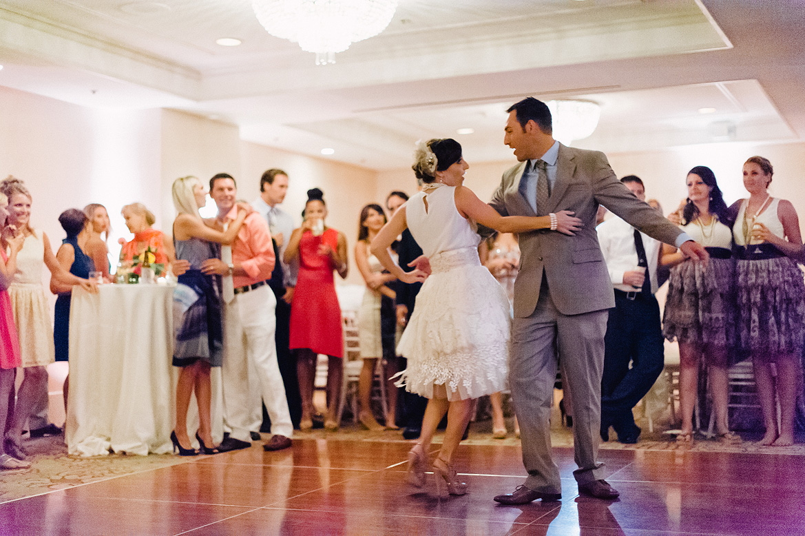 bride in vintage dress and groom in gray suit do choreographed first dance at l'auberge del mar wedding reception