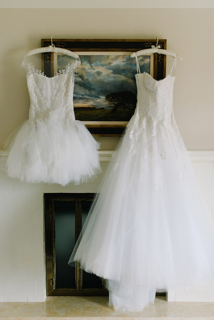 monique lhuillier gown and reception dress hang in montage laguna beach hotel room