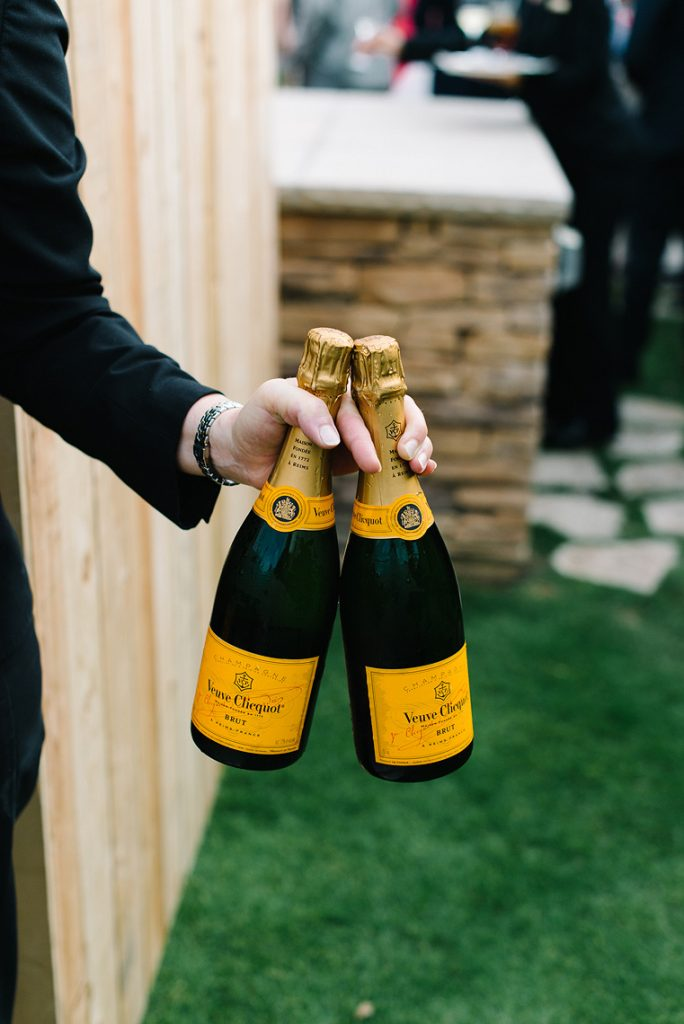 server holding two bottles of veuve clicquot champagne