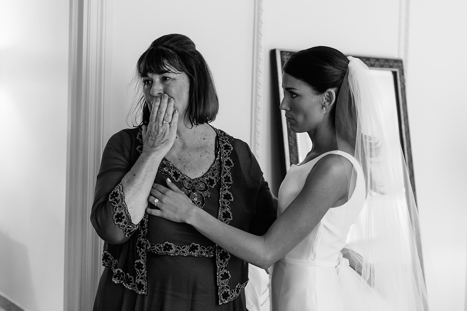 bride's mother cries after seeing daughter in wedding gown