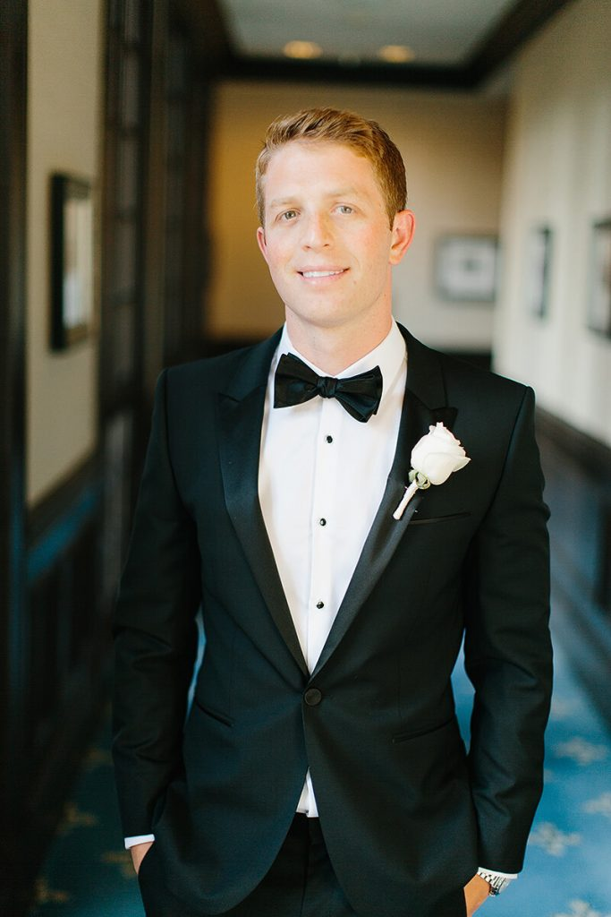groom poses in hallway of us grant hotel