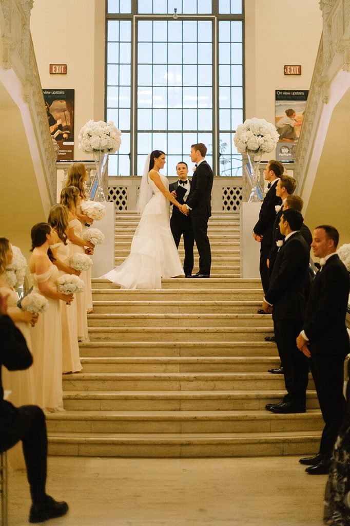 bride and groom on steps for san diego museum of art wedding