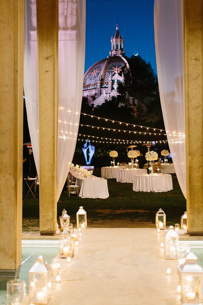 candles and tables in the sculpture court and garden at san diego museum of art wedding