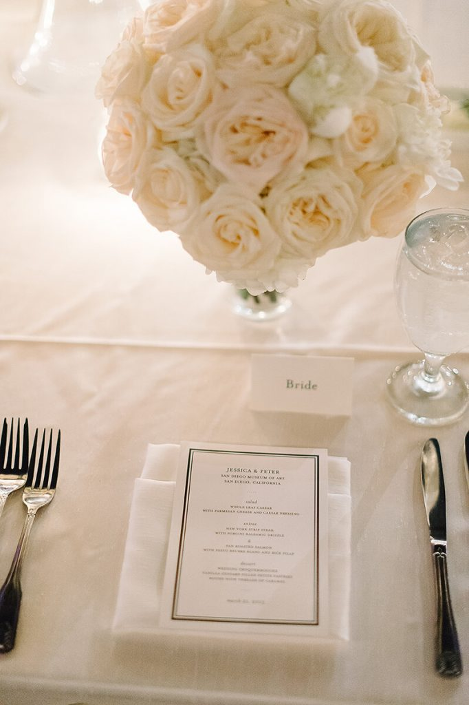 dinner menu and floral centerpiece at san diego museum of art wedding