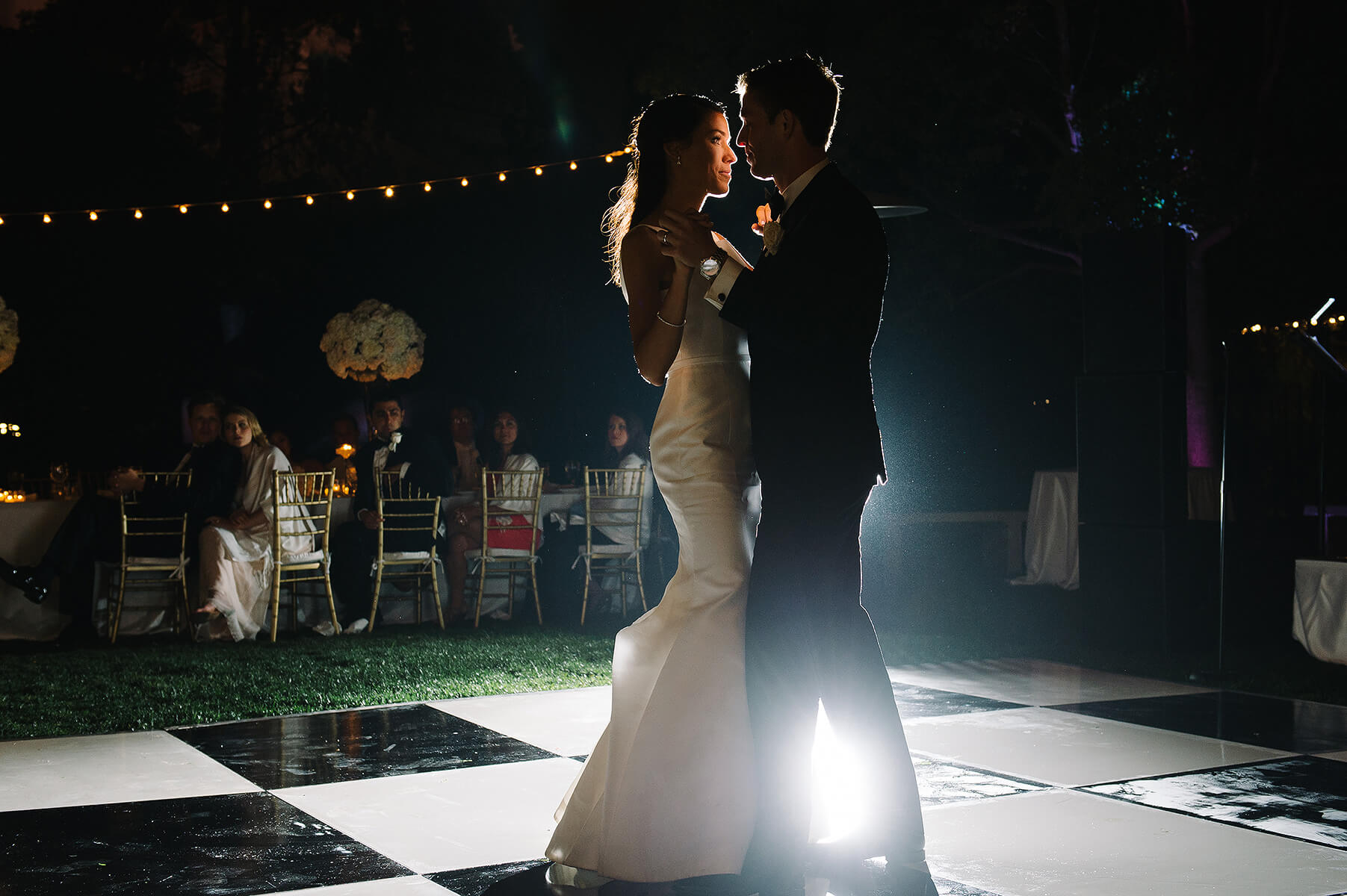 bride and groom first dance on checkerboard dance floor at san diego museum of art