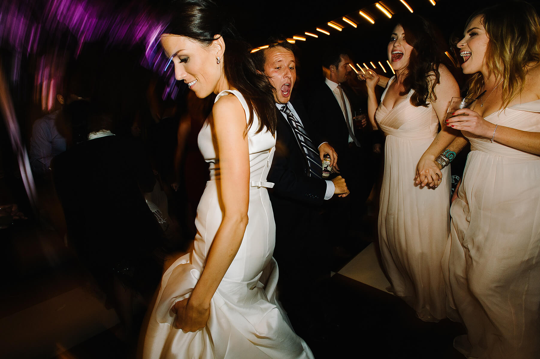 bride and guests dance at san diego museum of art wedding