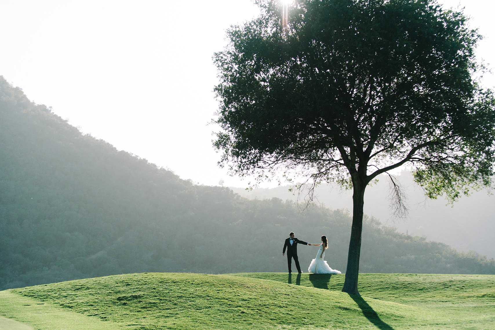 A couple dances on the golf course after their Vista Valley Country Club wedding
