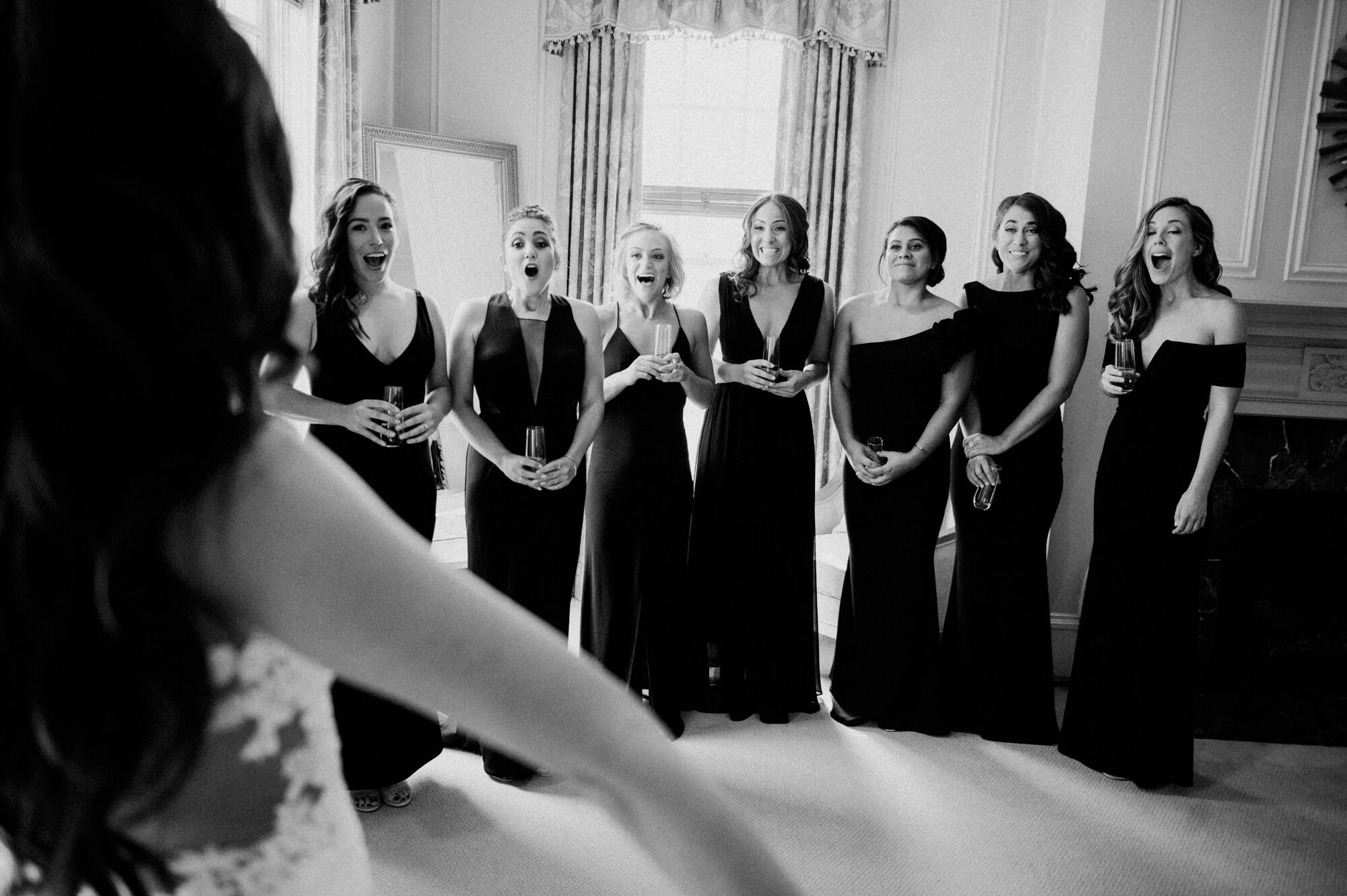 bridesmaids react to seeing bride in wedding gown