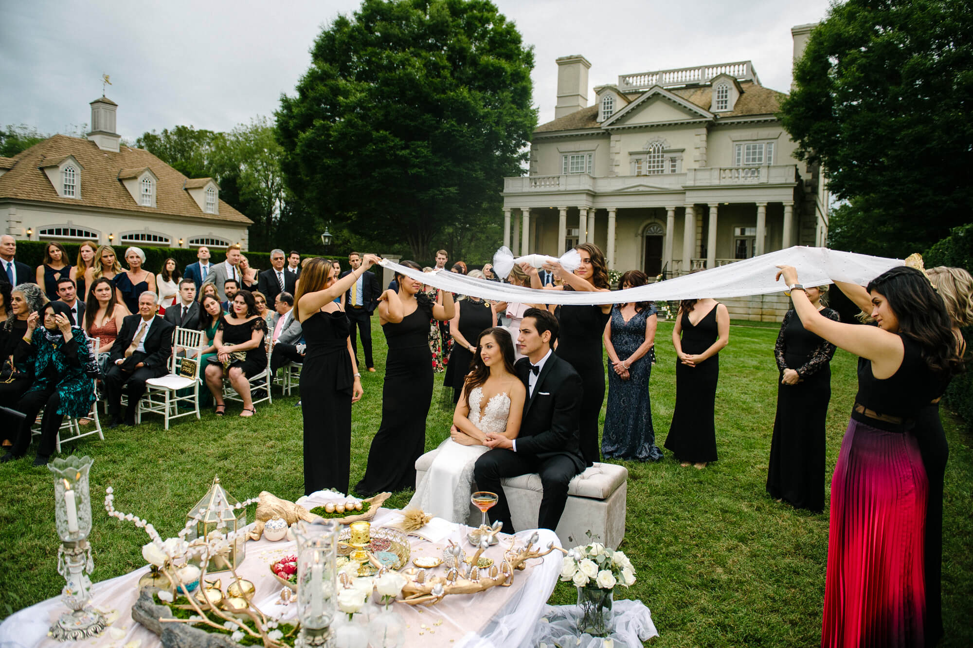 bride and groom under cloth for persian ceremony at great marsh estate