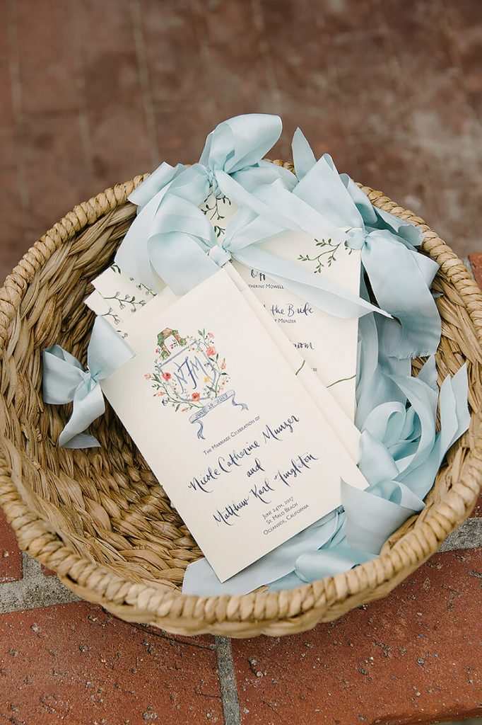 ceremony programs with baby blue ribbons st malo beach wedding