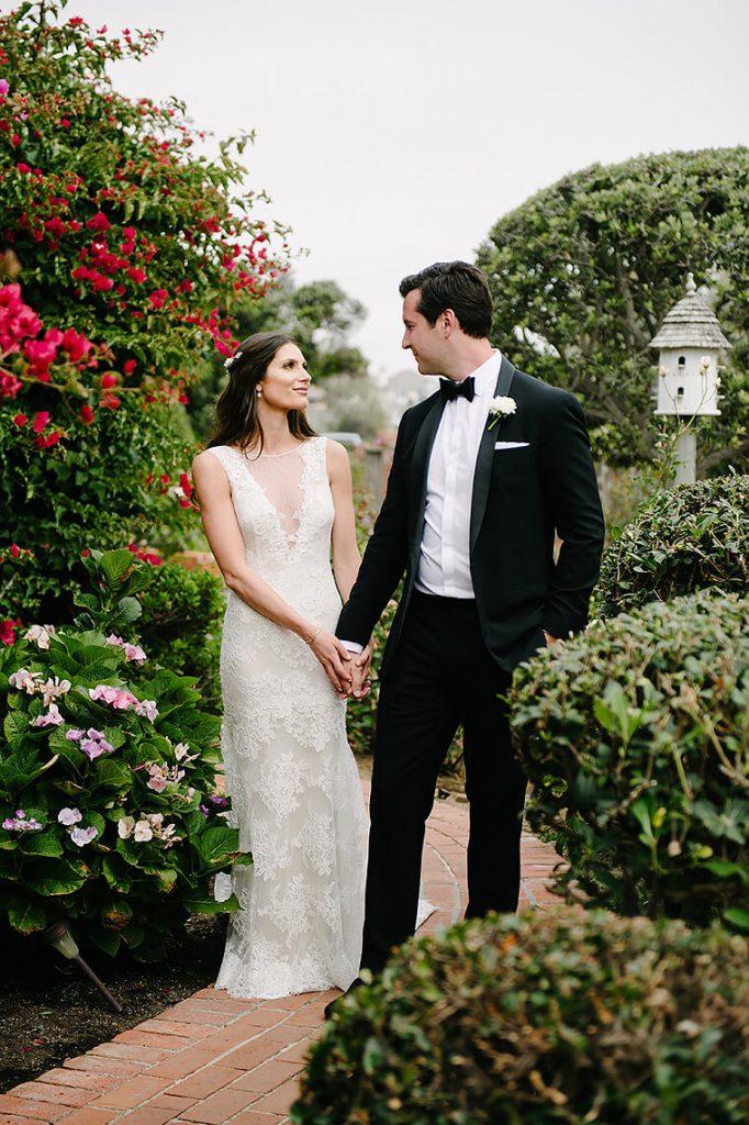 bride and groom walking through garden st malo beach wedding