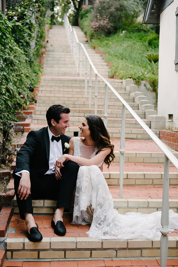 bride and groom laughing on brick steps st malo beach wedding