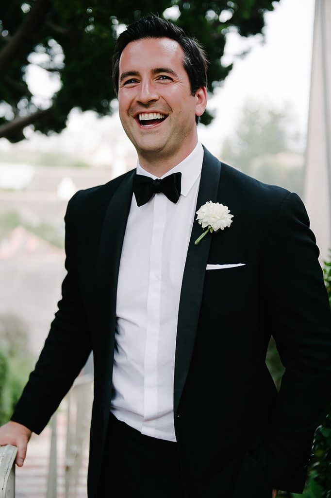 groom laughing st malo beach wedding