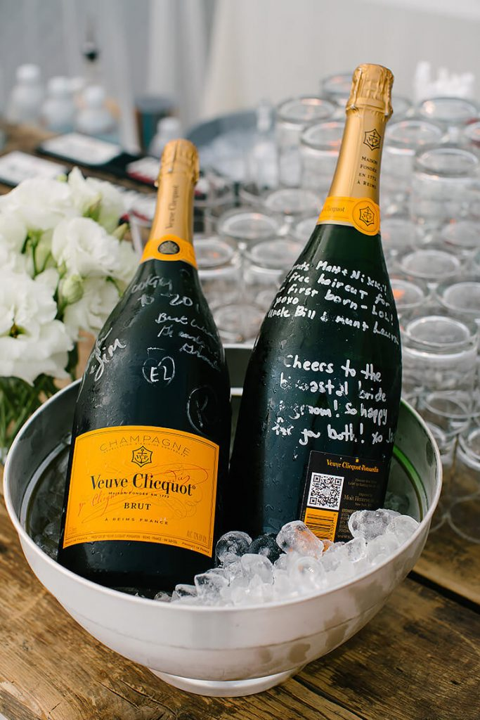 bottles of veuve clicquot with messages for bride and groom