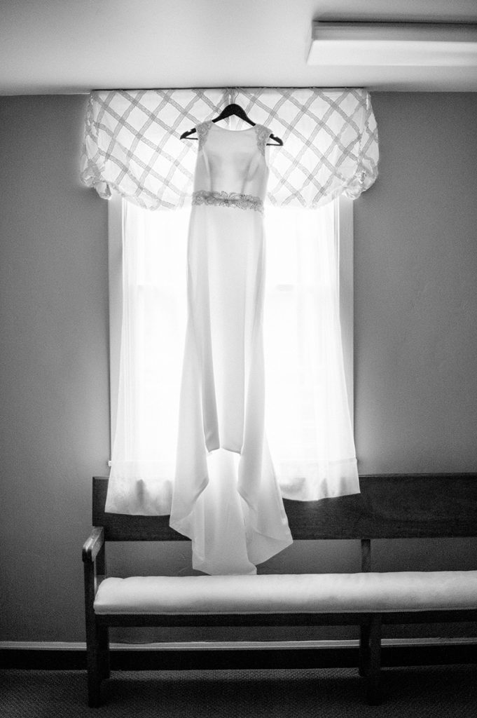 dress hangs in bridal suite at north chapel point loma