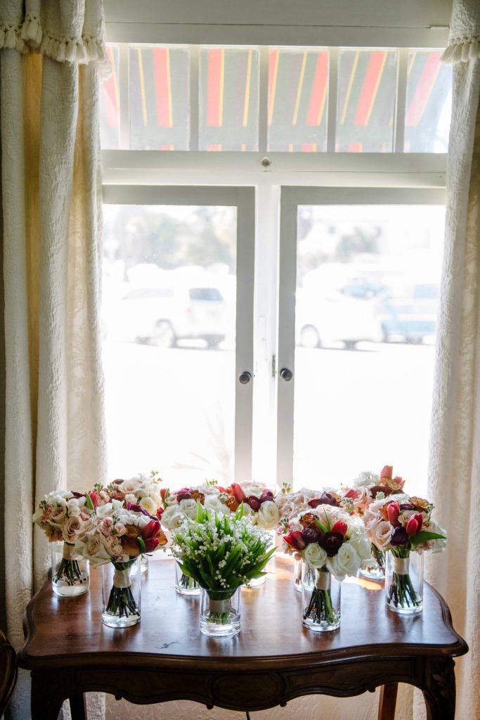 wedding bouquets in vases on wooden chest la jolla bed breakfast inn