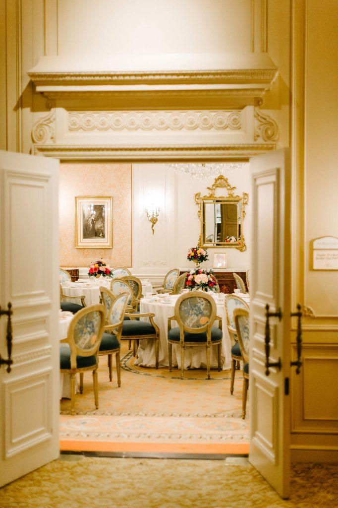 looking through doors to vintage tea party bridal shower