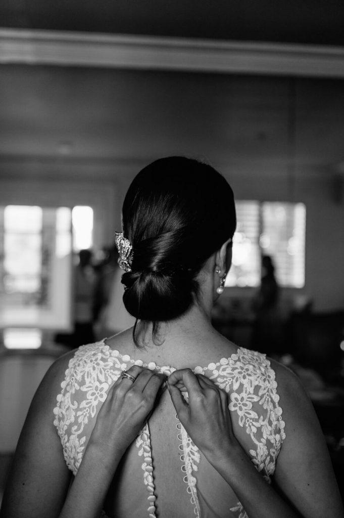 hands fasten clasp lace wedding gown la valencia
