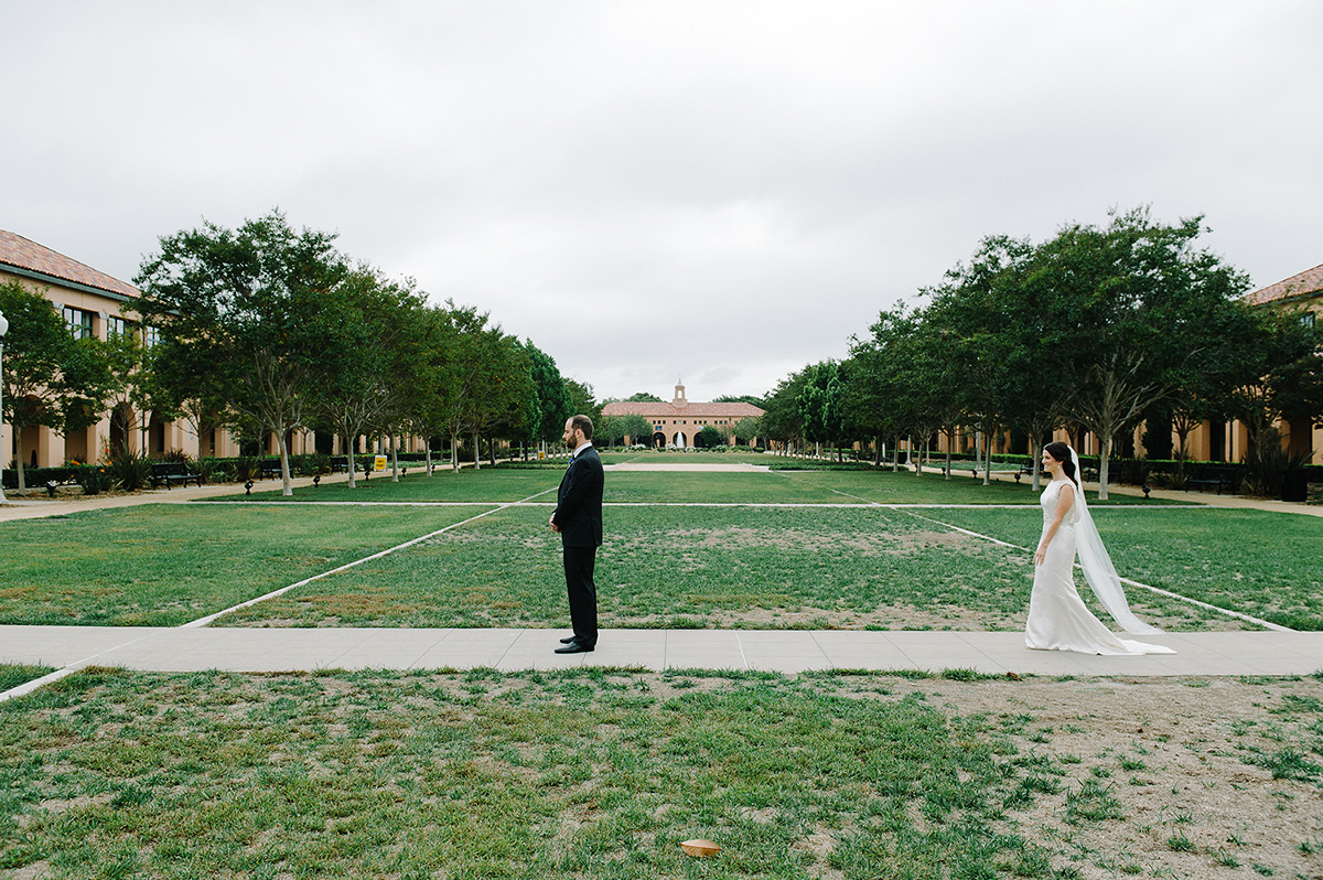bride walks toward groom first look liberty station