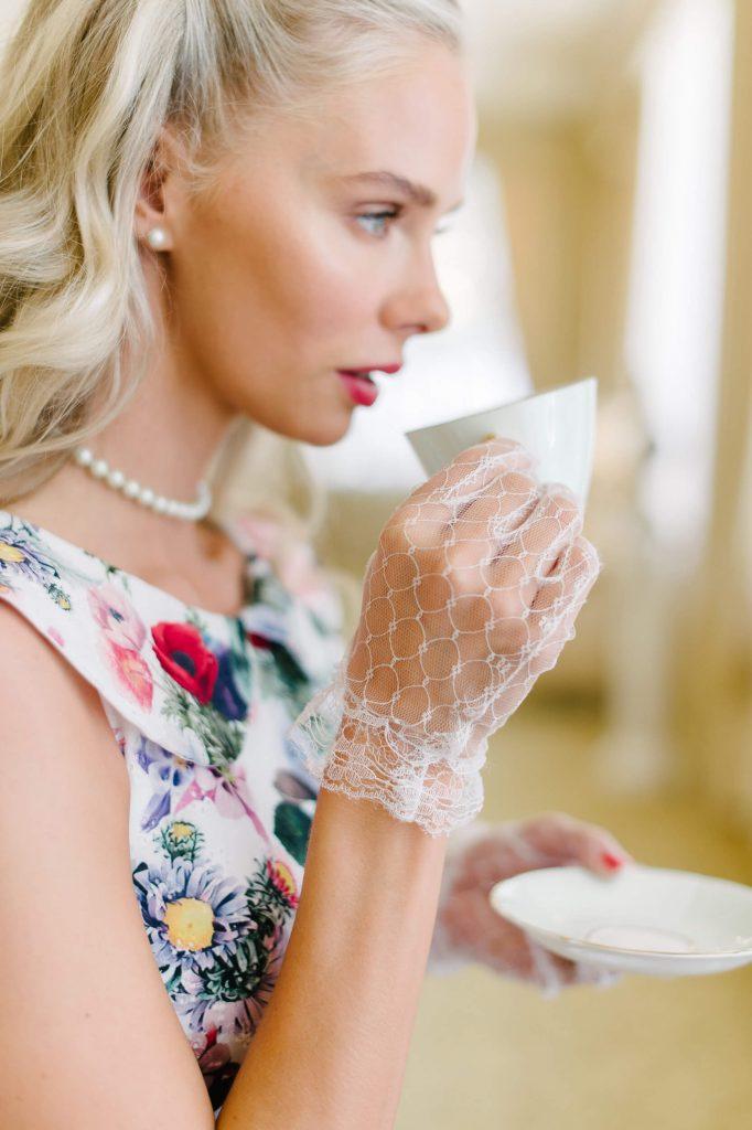 bride wearing lace gloves sips tea westgate hotel tea party bridal shower