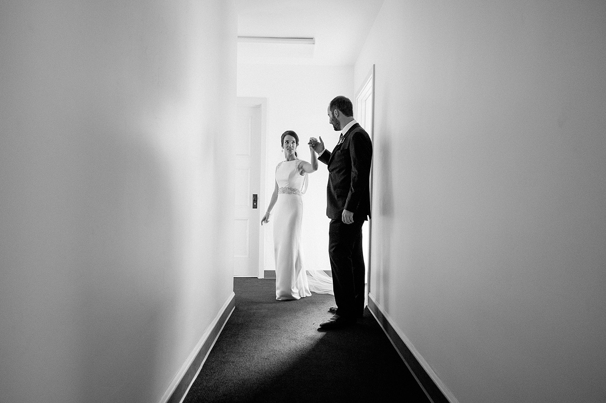 bride groom practice first dance hallway north chapel liberty station
