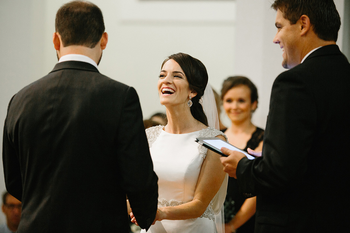 bride laughs during ceremony at north chapel point loma