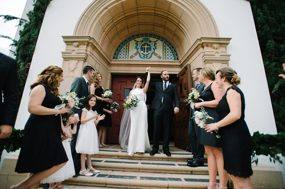 bride groom hold hands celebrate entrance steps north chapel liberty station