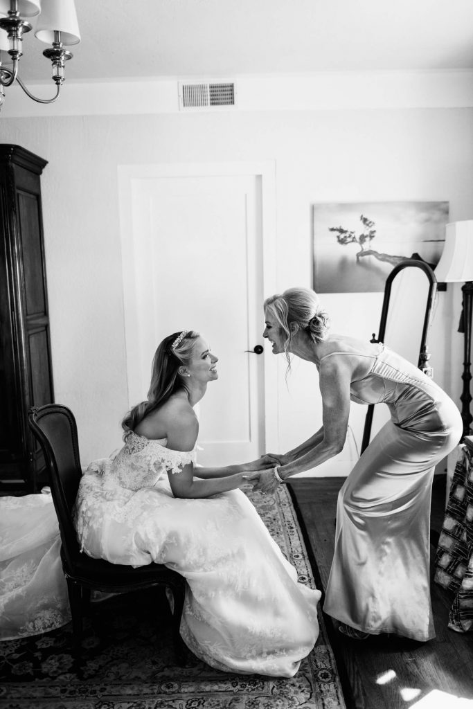 mother daughter bride hold hands smile