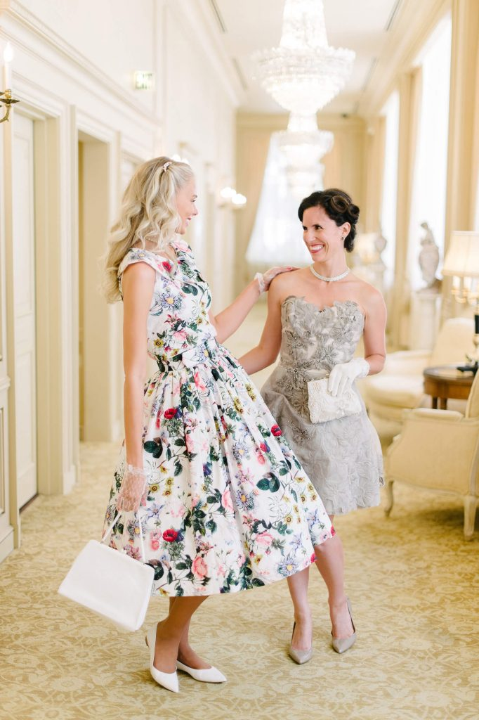 bride and bridesmaid in vintage a-line dresses at westgate hotel