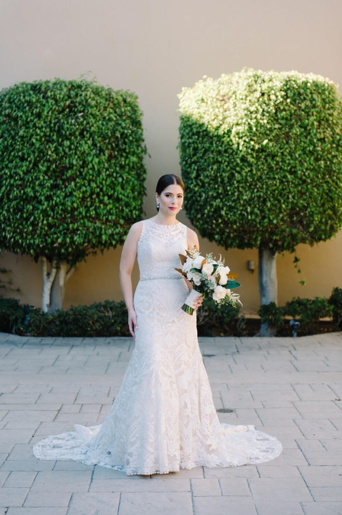 bride lace gown pose two ficus hedges all hallows church la jolla wedding