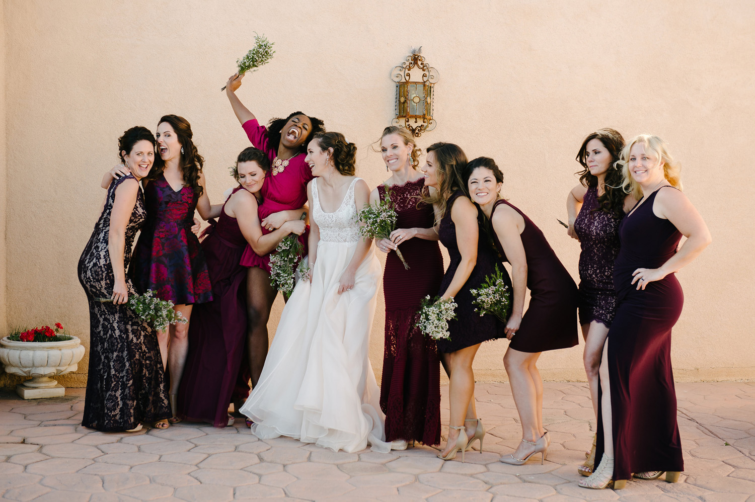 bridesmaids purple dresses laugh with bride