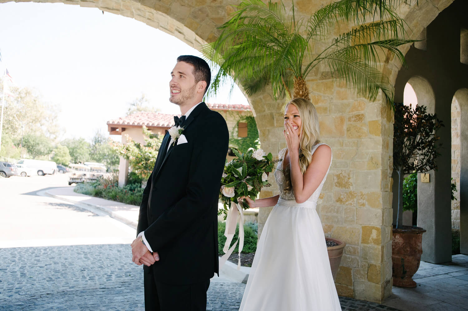 bride cries as she approaches groom during first look