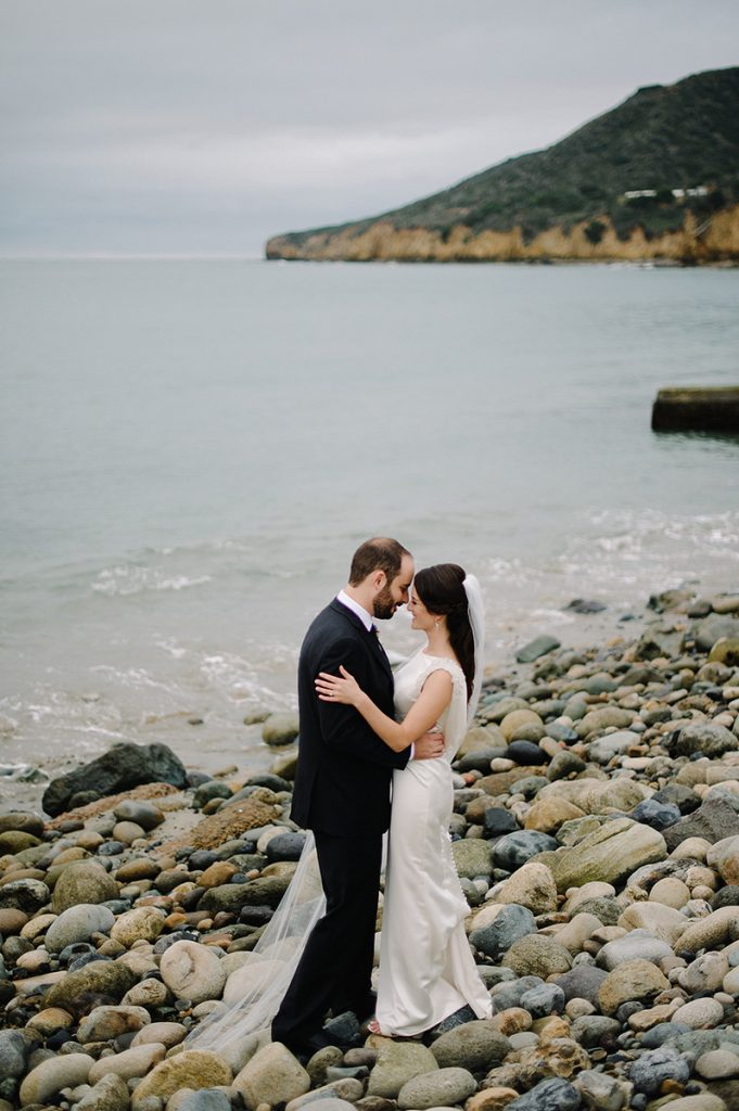 bride groom pose rocks point loma ocean