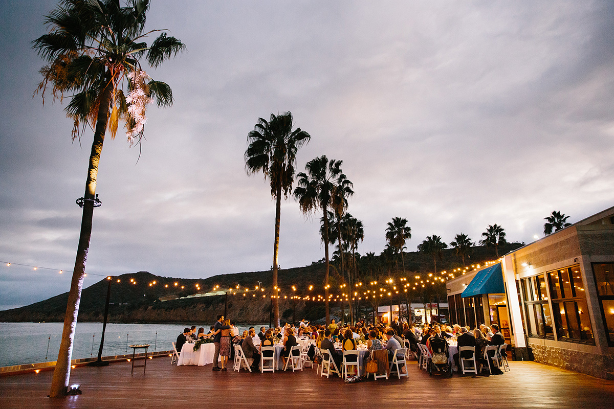 oceanview room deck with palm trees lights at dusk