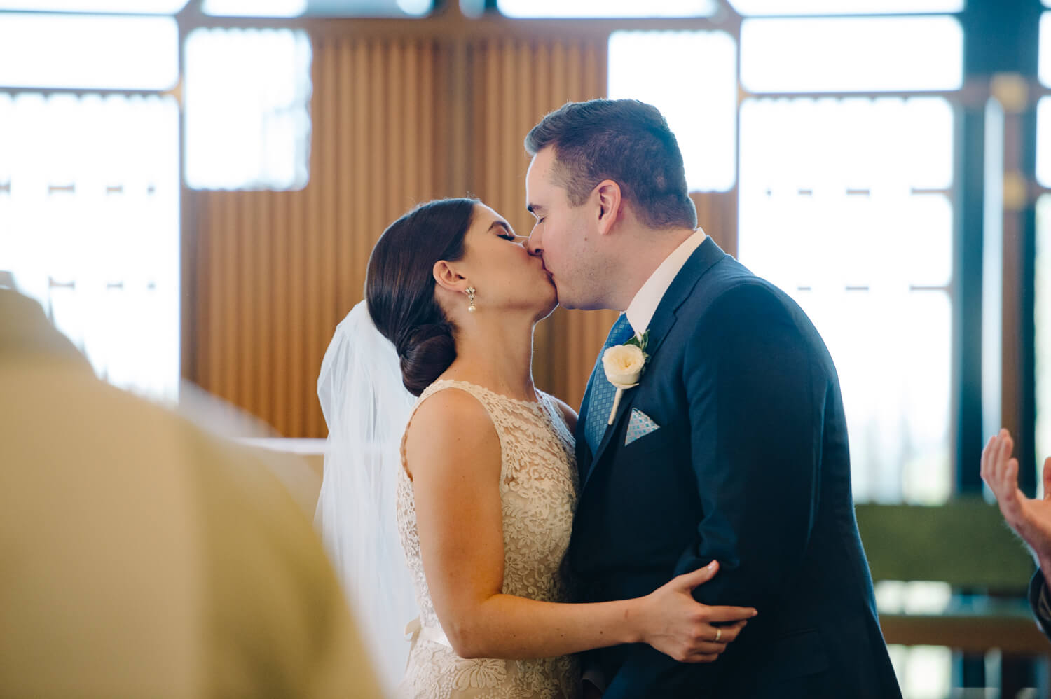bride and groom kiss during all hallows wedding ceremony