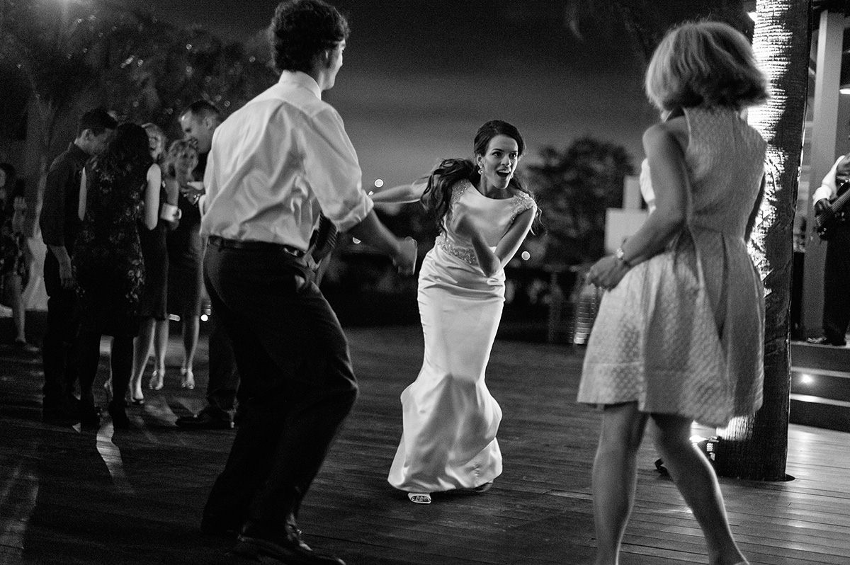 bride dances with guests oceanview room wedding reception